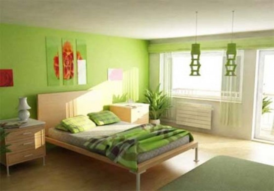 a bright bedroom in neon green, a floral three-piece artwork looks bold and springy
