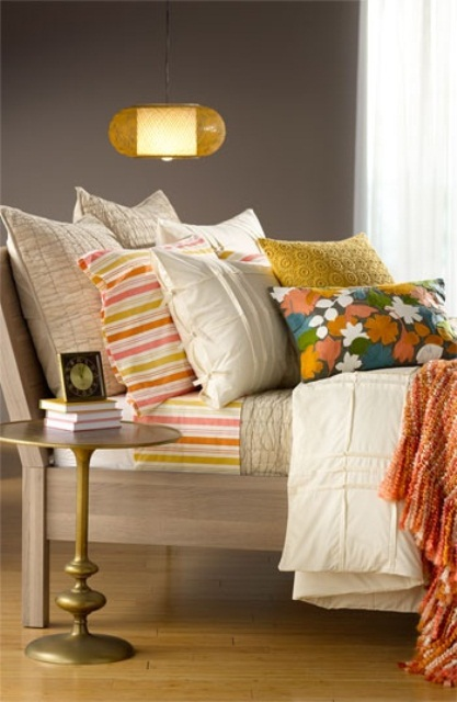 bright printed bedding refreshed the bedroom for spring, it's an easy way to do that
