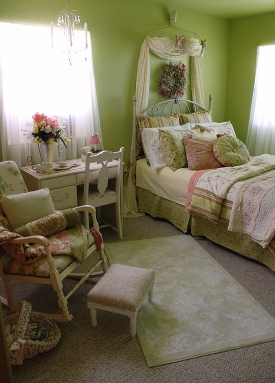 a spring bedroom with green walls, floral bedding and bright linens looks bold and bright