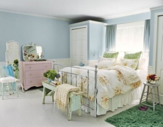 pastel walls and furniture, floral bedding make the bedroom feel like spring