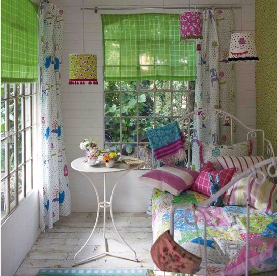 bold curtains, bright bedding, colorful lampshades refresh the space and make it cheerful and fun