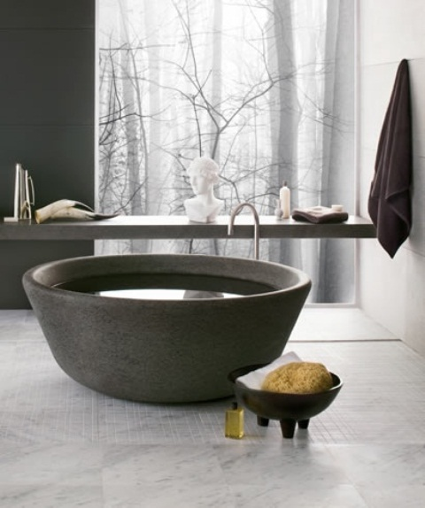 a unique bowl like stone bathtub is an ultimate solution for a contemporary or minimalist bathroom